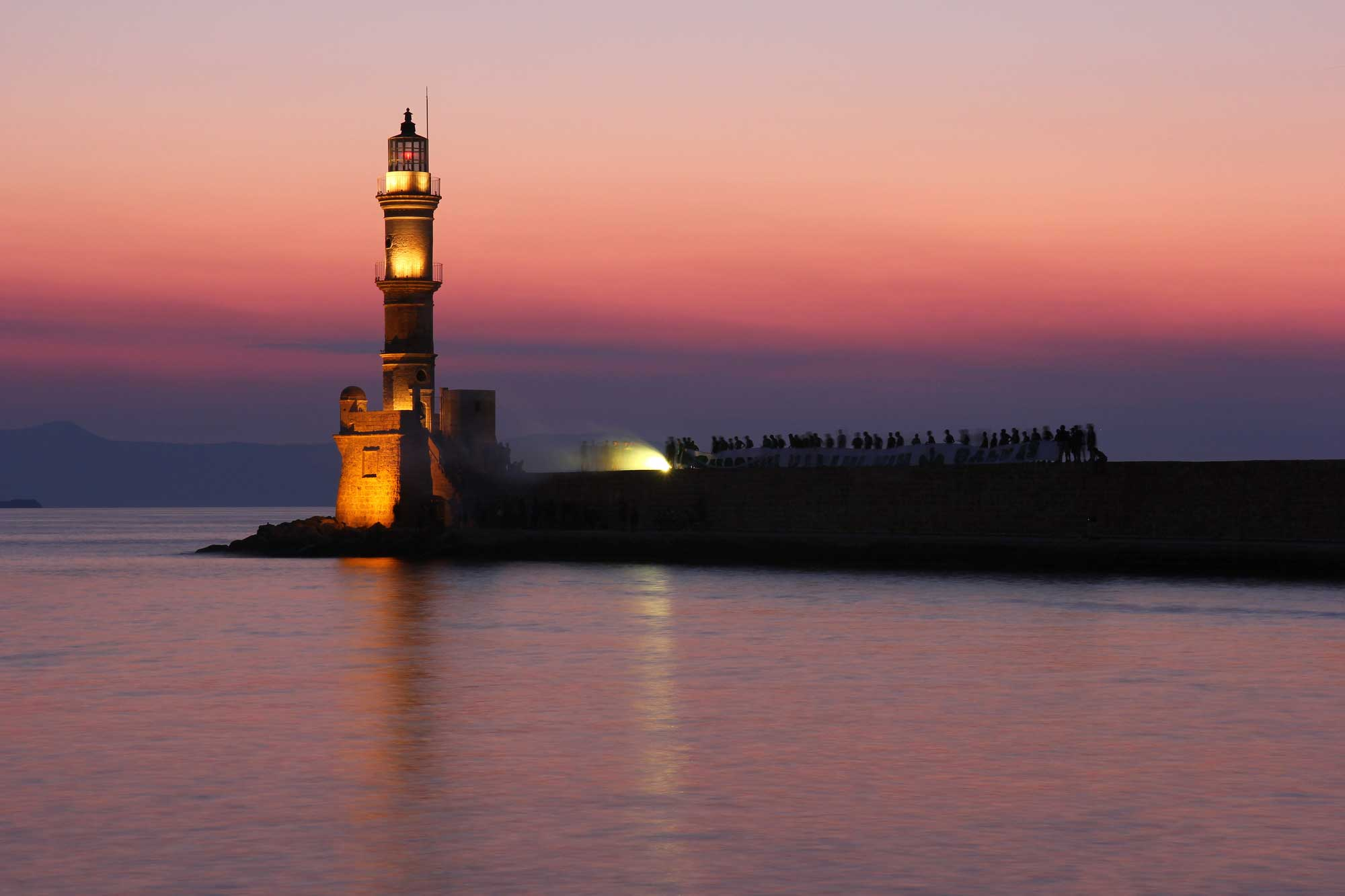 Egyptian Lighthouse In The Venetian Harbor Is The City Symbol Of Chania